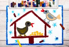 Colorful drawing: Bird feeder, winter and two cute birds. Feeder for the birds Royalty Free Stock Photo