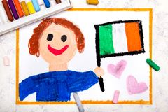 Colorful drawing: Happy man holding Irish flag. Flag of Ireland and smiling boy stock photography