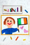 Colorful drawing: Happy man holding Irish flag. Flag of Ireland and smiling boy stock photo