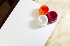 Different drawing paints on white piece of paper stock photos