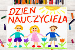 Colorful drawing: Polish words TEACHER`S DAY. Photo of colorful drawing: Polish words TEACHER`S DAY and happy children Royalty Free Stock Images