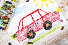 Colorful drawing : red car. Colorful drawing and crayons: red car Stock Image