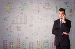 Colorful drawings on wall with businessman Stock Photos