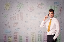 Colorful drawings on wall with businessman Stock Photo