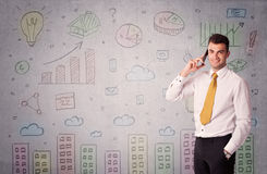 Colorful drawings on wall with businessman Stock Images