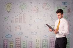 Colorful drawings on wall with businessman Stock Image