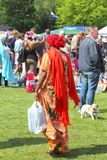 Orange dressed Muslim woman is shopping at the flea market (vrijmarkt), Kingsday in Holland Royalty Free Stock Image
