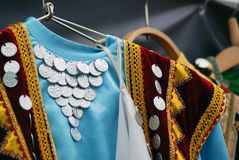 Colorful dresses decorated by coins. Stock Photo