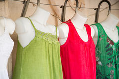 Colorful dresses on a shop window doll. Dress royalty free stock image