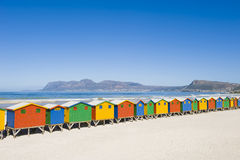 Colorful dressing huts on the beach. Brightly colored dressing huts on Muizenberg beach near Cape Town Royalty Free Stock Photography
