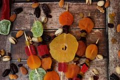 Colorful dried fruits for the Jewish holiday of Tu Bishvat. Bouquet of dried fruits on a wooden table background for the Jewish holiday of Tu BiShvat stock images