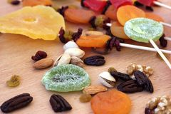 Colorful dried fruits for the Jewish holiday of Tu Bishvat. Close up of various dried fruits on a wooden table for the Jewish holiday of Tu BiShvat stock photography