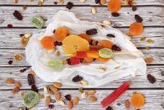 Colorful dried fruits for the Jewish holiday of Tu Bishvat. Various dry fruits on a wooden table background for the Jewish holiday of Tu BiShvat royalty free stock images