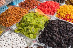 Colorful dried salted or sugared Asian tropical fruits royalty free stock photos