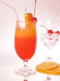 Colorful drink with cherry. And other fruits Royalty Free Stock Photo