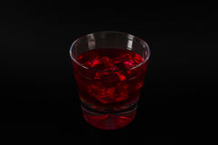 Colorful drink in a cocktail glass, with ice cubes, summer drink Royalty Free Stock Image