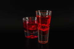 Colorful drink in a cocktail glass, with ice cubes, summer drink Royalty Free Stock Photo
