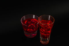 Colorful drink in a cocktail glass, with ice cubes, summer drink Royalty Free Stock Photos