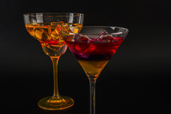Colorful drink in a cocktail glass, with ice cubes, summer drink Stock Images