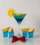 Colorful drink in a martini glass, blue and green combination, f Stock Photos
