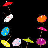 Colorful drink umbrellas Stock Images