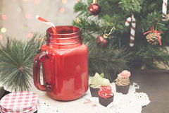 Colorful drinking jar under christmas tree Stock Photo