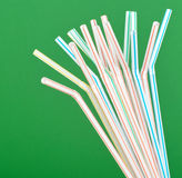 Colorful drinking straws. Abstract and colorful drinking straws on green background celebration concepts Stock Photography