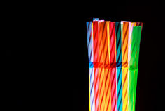 Colorful drinking straws on black background Royalty Free Stock Images