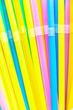 Colorful drinking straws close-up background, colorful plastic Stock Image