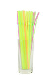 Colorful drinking straws in glass on white background. Royalty Free Stock Photography