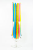 Colorful drinking straws in glass  on white background Stock Images