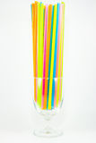 Colorful drinking straws in glass  on white background Royalty Free Stock Images