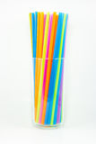 Colorful drinking straws in glass  on white background Royalty Free Stock Photo