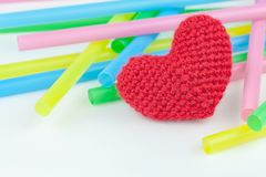 Colorful drinking straws. And heart on white background Stock Photography