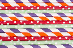 Colorful drinking striped straws as a background Royalty Free Stock Photos