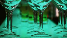 Set of colorful cocktails on the bar counter at holiday party. Colorful drinks in cocktail glasses glowing on the bar counter n royalty free stock photos