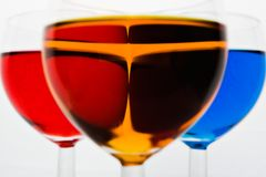 Colorful drinks in glasses stock photography