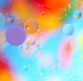 Colorful drops of oil on water Stock Photos