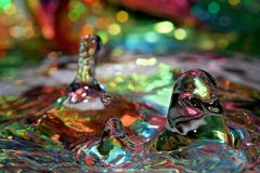 Colorful drops of water. Macro view of colorful drops of water splashing Stock Images