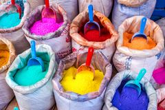 Colorful pigments in bags Stock Images