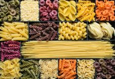Colorful dry pasta background stock photo