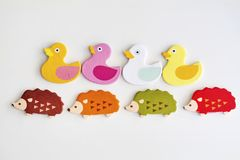Colorful Ducks and Hedgehogs in a Row. On a White Background Stock Image