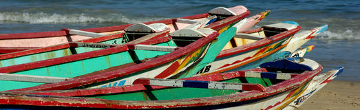 Colorful dugouts. Some colorful fishing dugouts on a beach in Senegal, west Africa Royalty Free Stock Image