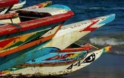 Colorful dugouts. Some colorful fishing dugouts on a beach in Senegal, west Africa royalty free stock photo