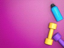 Colorful dumbbells with bottle Royalty Free Stock Photography