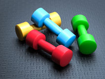 Colorful dumbbells Stock Images