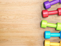 Colorful dumbbells Stock Photos