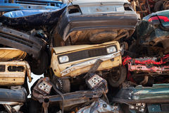 Colorful dump of stacked cars in junkyard Royalty Free Stock Image