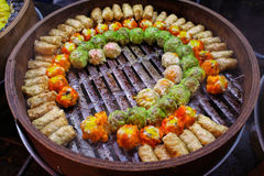 Colorful dumplings in wooden bowl Stock Photos