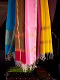 Colorful dupatta Scarfs hanging in a market-India. Colorful dupatta Scarfs hanging in a shop. A length of material worn arranged in two folds over the chest and stock images